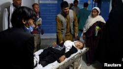 An injured schoolgirl is transported to a hospital after the blast in Kabul.