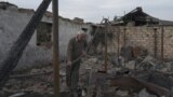 A man stands in the ruins of his farm, which was destroyed by shelling near the village of Taghavard in Nagorno-Karabakh.