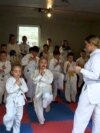 Bosnia and Herzegovina, Bihac, Children practice karate in the garage, video grab