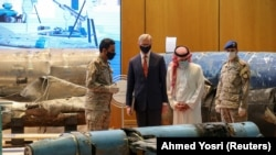 Saudi Arabia's FM Adel al-Jubeir (second from R) and U.S. Special Representative for Iran Brian Hook (second from left) inspect a display of the debris of ballistic missiles and weapons that the Saudis say were supplied by Iran to Huthi rebels in Yemen. June 29, 2020