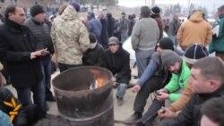 أخبار مصوّرة 27/02/2014: من الاشتباكات بين المتظاهرين في الجنوب من أوكرانيا إلى إضراب في جورجيا