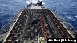 The U.S. Navy said the cache of seized weapons included dozens of Russian-made anti-tank guided missiles; thousands of Chinese Type 56 assault rifles; and hundreds of PKM machine guns, sniper rifles, and rocket-propelled grenades launchers.