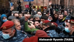 ARMENIA -- Riot police confront opposition protesters demanding the resignation of Armenian Prime Minister Nikol Pashinian. in Yerevan, December 10, 2020