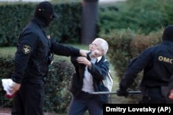 Opposition activist Nina Baginskaya, 73, fights with police at a rally in Minsk on August 26.