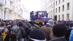 Protesters, Tractor Take On Police In Kyiv
