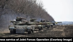 Ukrainian tanks participate in drills at an undisclosed location in the eastern part of the country.