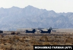 Two U.S. CH-47 Chinook helicopters on the ground at Pakistan's Shamsi Airfield in 2002. It later emerged that the airfield was being used to launch U.S. drone strikes against Al-Qaeda targets in Pakistan's tribal regions.