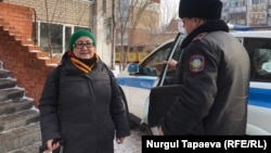 Aigul Otepova is shown as she is removed from her apartment before being taken to a psychiatric clinic in Nur-Sultan on November 23.