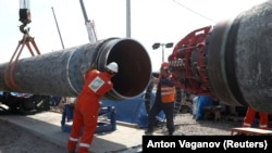 Workers are seen at the construction site of the Nord Stream 2 gas pipeline near the town of Kingisepp in Russia's Leningrad region.