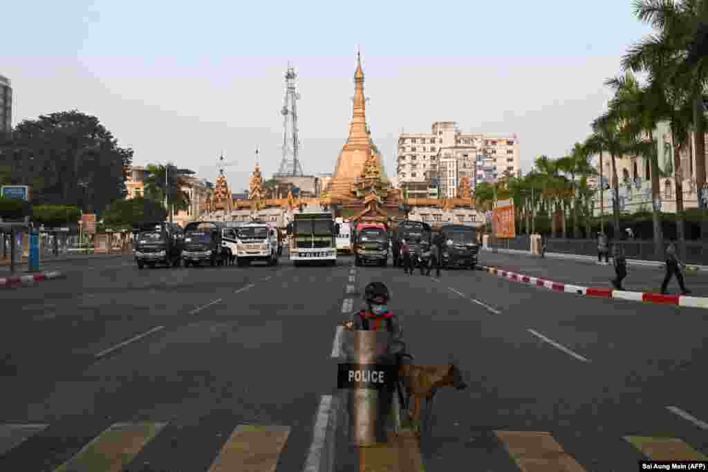 BURMA -- MYANMAR -- Police stand guard on a barricaded road outside the Yangon City Hall (Right) and Sule Pagoda (Center) in Yangon on February 16, 2021.