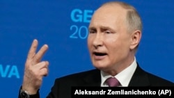 Russian President Vladimir Putin gestures as he speaks during a news conference after his meeting with U.S President Joe Biden in Geneva on June 16.
