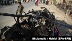 The aftermath of a roadside bomb blast that killed six civilians on the outskirts of Jalalabad on July 21.