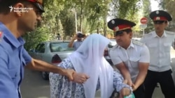 Mother Of Tajik Attack Suspect Pours Gasoline On Herself In Protest