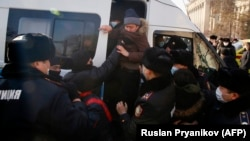 Police detain opposition supporters in Almaty during Kazakhstan's parliamentary elections on January 10.