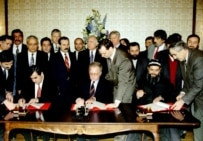 The signing of a cease-fire agreement that ended hostilities in December 1996 (TASS)