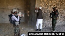 Afghan soldiers conduct a security check during operations in Achin district of the eastern Nangarhar province in January