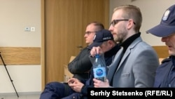 Michal Prokopowiczsitting (wearing glasses) in a courtroom in Krakow, Poland, on January 14, 2019.