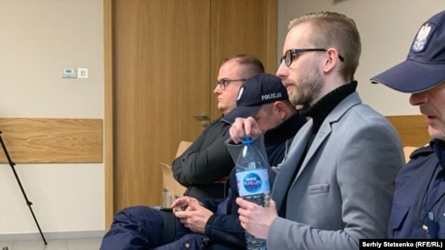 Michal Prokopowiczsitting (wearing glasses) in a courtroom in Krakow, Poland on January 14, 2019.