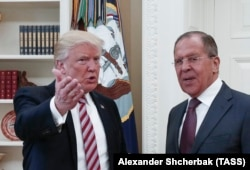 U.S. President Donald Trump greets Russian Foreign Minister Lavrov at the White House last month.