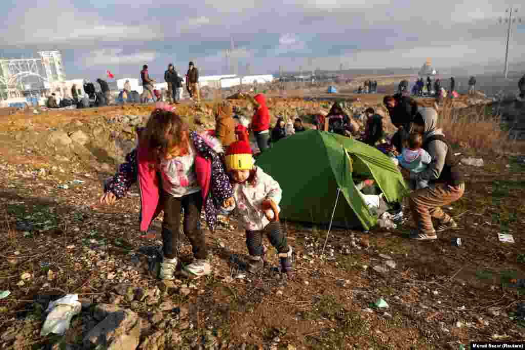 """Child refugees from Syria are seen near Turkey's Ipsala border crossing with Greece on March 2.Amid an escalation of the Syrian conflict, Turkish media reported that hundreds of migrants were flocking to Turkey's borders with Greece and Bulgaria after a senior official was quoted as saying Ankara had decided """"not to stop Syrian refugees from reaching Europe."""""""