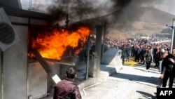 Protestors set fire to a toll booth during clashes with police on March 31 at a toll plaza on the Durres-Kukes Highway, linking Albania with Kosovo.