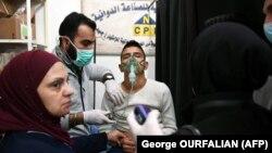 Пострадавшие при предположительно химической атаке в Алеппо. 24 ноября 2018 года.