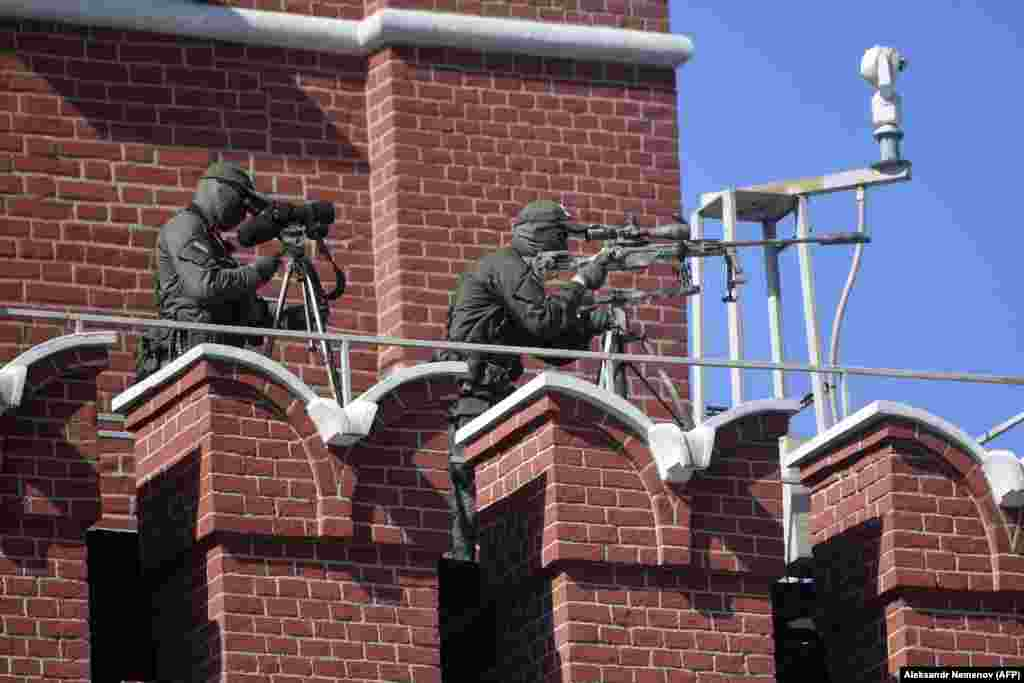 Russian snipers secured the area around the military parade.
