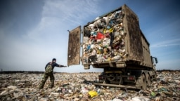 A truck dumps garbage at the Yadrovo site outside Moscow.