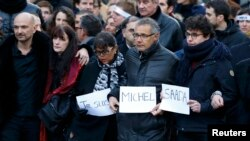 Family members and relatives of the 17 victims take part in a solidarity march in the streets of Paris on January 11.