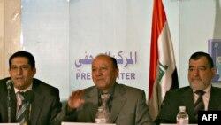 رئيس وبعض أعضاء مفوضية الإنتخابات