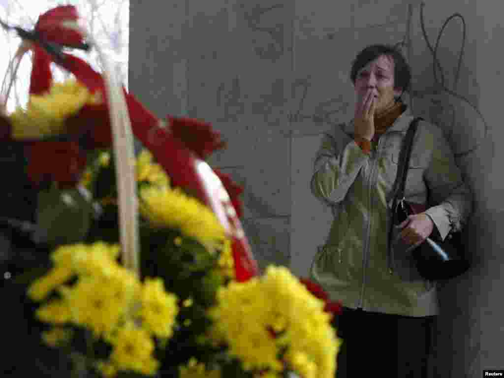 A woman cries at the entrance to Kastrychnitskaya subway station in Minsk on April 13, where a total of  13 people were killed  and about 200 injured in the explosion on April 11. Photo by Vladimir Nikolsky for Reuters