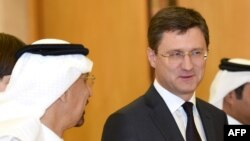 Russian Energy Minister Aleksandr Novak (right) talks with Saudi Oil Minister Khalid al-Falih at an OPEC meeting.