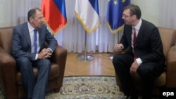 Serbian Prime Minister Aleksandar Vucic (right) meets with Russian Foreign Minister Sergei Lavrov in Belgrade on December 12.