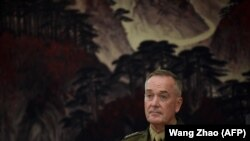 The chairman of the U.S. Joint Chiefs of Staff, General Joseph Dunford, listens as he meets with the Chinese deputy chairman of the Central Military Commission in Beijing on August 17.