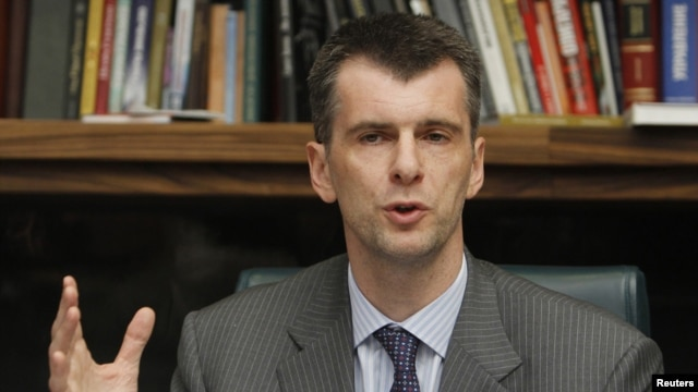 Russian billionaire Mikhail Prokhorov gestures during a news conference in Moscow on September14.