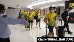 Delegația Australiei sosind în Aeroportul Internațional Narita. 17 iulie 2021