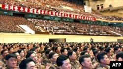 Military officers celebrate the second successful nuclear test at the Pyongyang Indoor Stadium on May 26