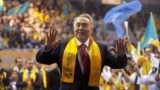 Kazakhstan - (FILES) In this file photo taken on April 04, 2011 Kazakh President Nursultan Nazarbayev greets his supporters during a celebration rally at a sports center in Astana. - Kazakhstan President Nursultan Nazarbayev announced his shock resignatio