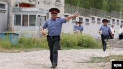Kyrgyz police officers in front of the Chinese Embassy on August 30, 2016.