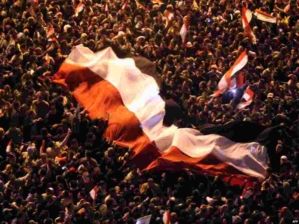 Protesters celebrate in Tahrir Square after the announcement by Vice President Omar Suleiman that Mubarak had stepped down on February 11, 2011.