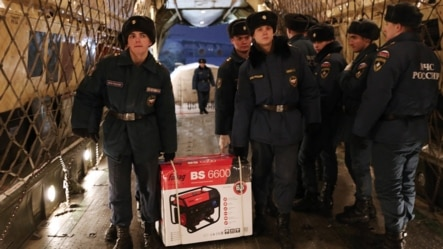 Workers in Moscow load gasoline-powered generators into an Ilyushin IL-76 airlifter belonging to Russia's Emergency Situations Ministry before sending them to Crimea on November 24.