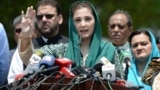 FILE: Maryam Nawaz (C), daughter of former Prime Minister Nawaz Sharif, talks to journalists after appearing before an investigation team in Islamabad on July 5.