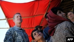 Commander of the NATO-led International Security Assistance Force (ISAF) U.S. General Stanley McChrystal visits a local bazaar in Afghanistan's Logar Province in late August.