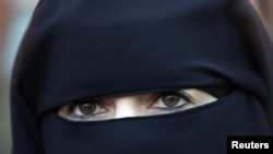 The niqab leaves only the eyes of the woman exposed.