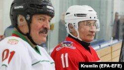 Russian President Vladimir Putin (right) and Belarusian President Alyaksandr Lukashenka take a rest during a match of the Night Hockey League teams in Rosa Khutor in the Black Sea resort of Sochi on February 7.