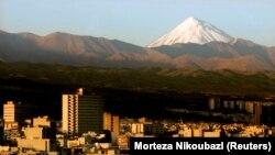 Mount Damavand, a potentially active volcano 66 km (41 miles) northeast of the Iranian capital Tehran.