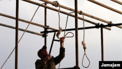 An Iranian soldier prepares a noose ahead of a public hanging. Will watching a video of such a hanging spur opposition to the practice, or just desensitize the viewer?