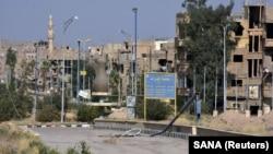 Оштетени згради од воздушните напади во провинција Деир ал Зор.