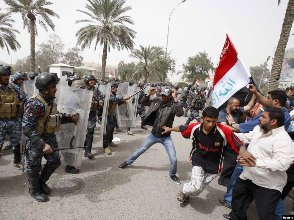 Iraqi Journalists Press Charges Against Riot Police