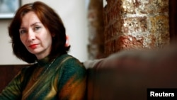 Natalya Estemirova poses at the Front Line Club in London in 2007, where she was awarded the first annual Anna Politkovskaya award for women defenders of human rights in war.